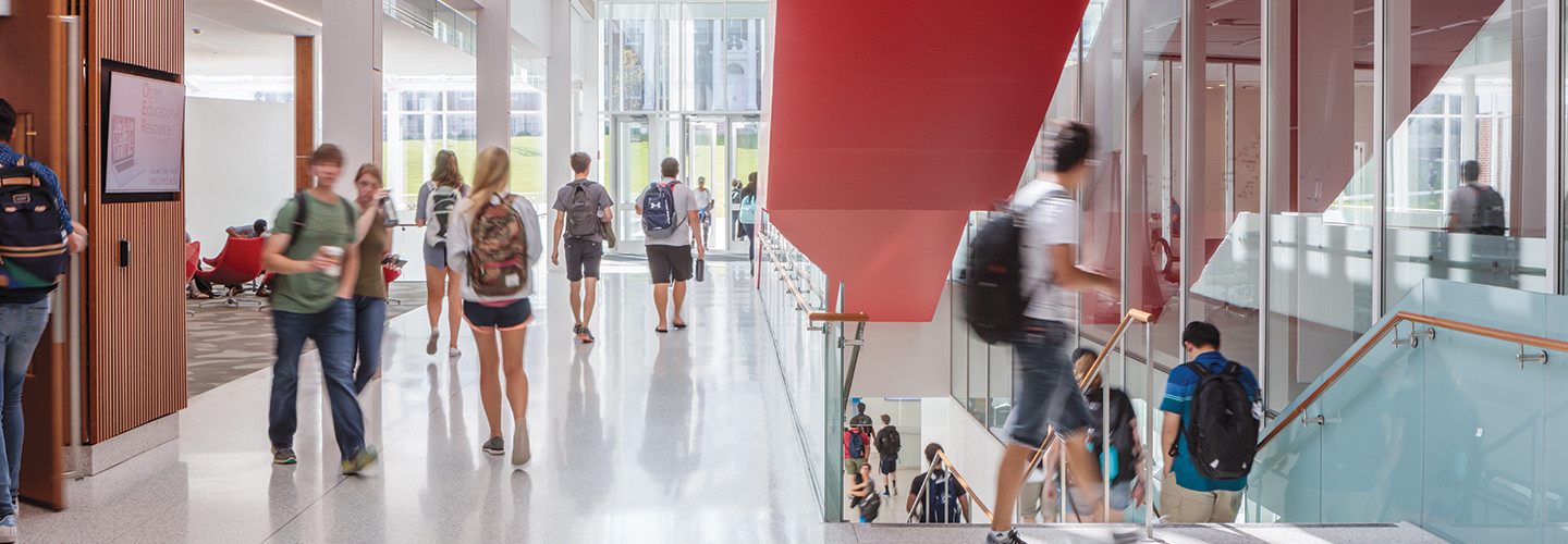 UMD students walking in learning center