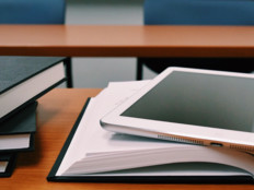 iPad on top of book