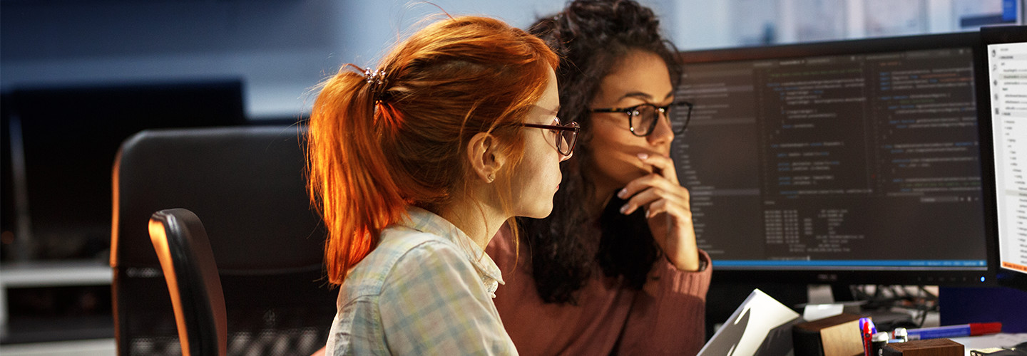 Two women staring at a computer