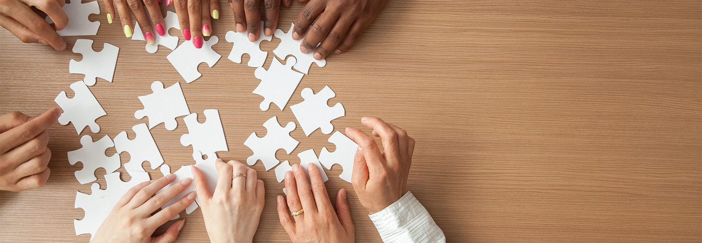 People work to put a puzzle together