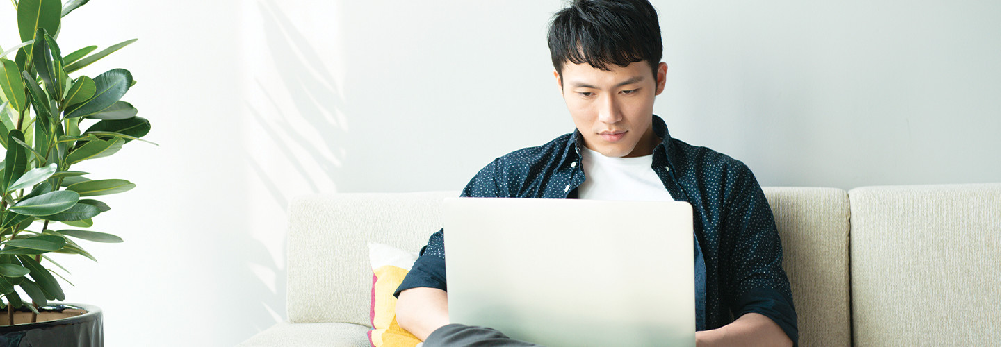 college student using laptop at home