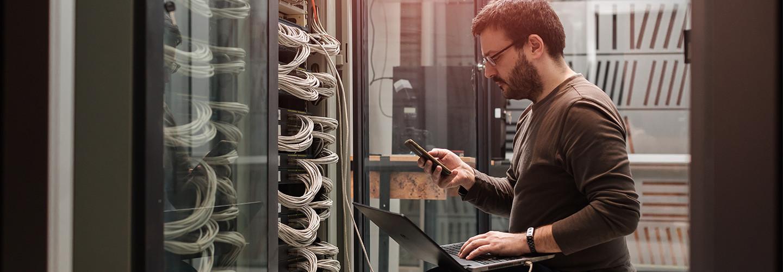 Guy working on data center