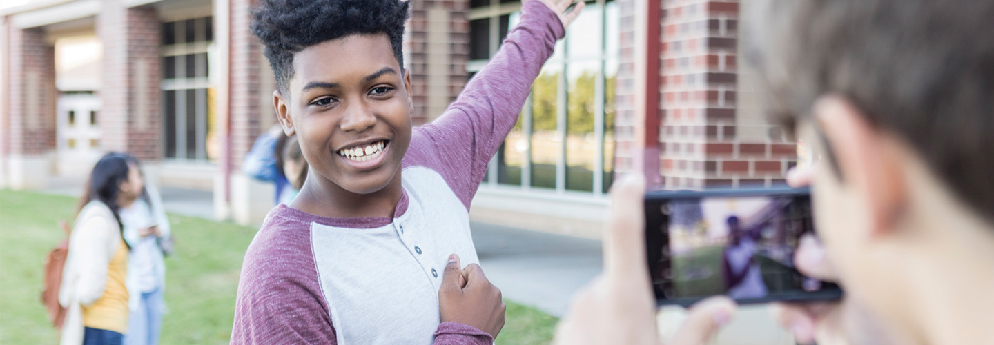 Smiling student gives campus tour