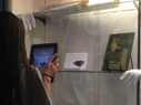 washcoll girl uses AR to study an artifact
