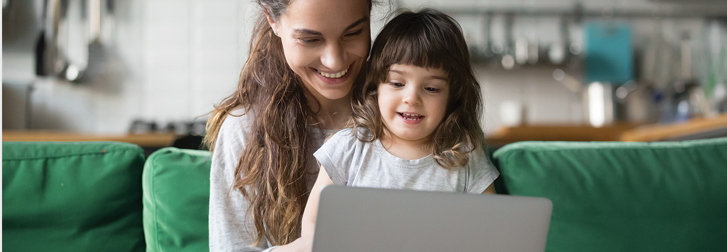 parent and child looking at laptop