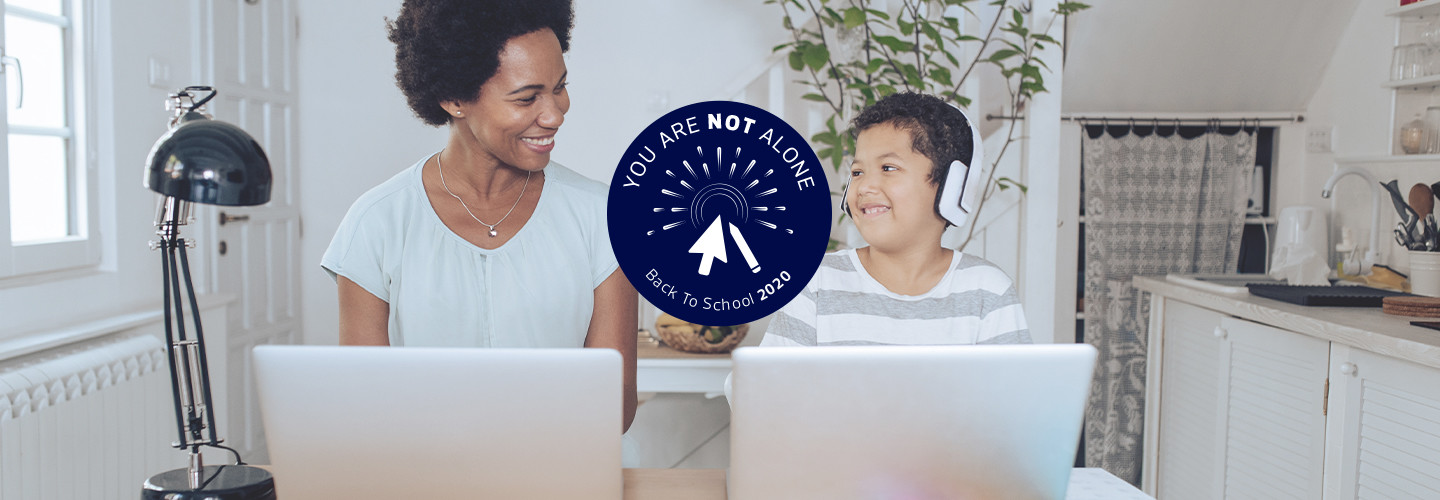 mother helping young son with online learning