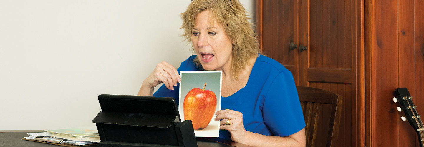 woman doing speech-language therapy online