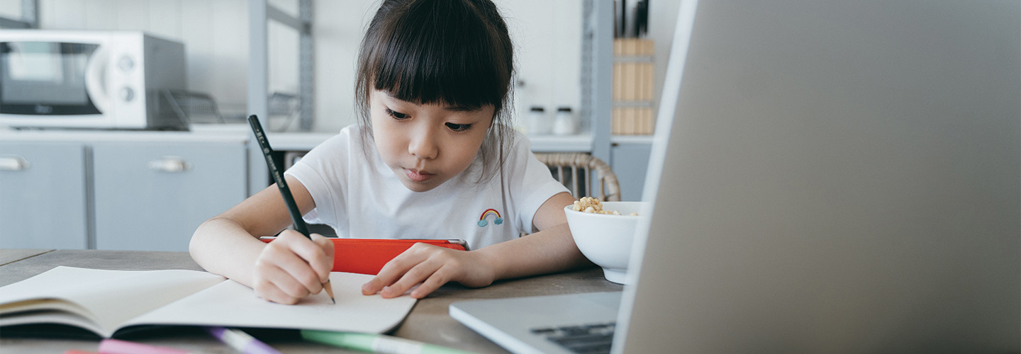 girl studying from home with laptop