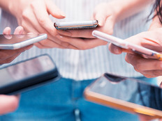 Group of people holding their smartphone and testing a mobile app.