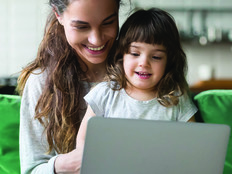 woman and child look at laptop
