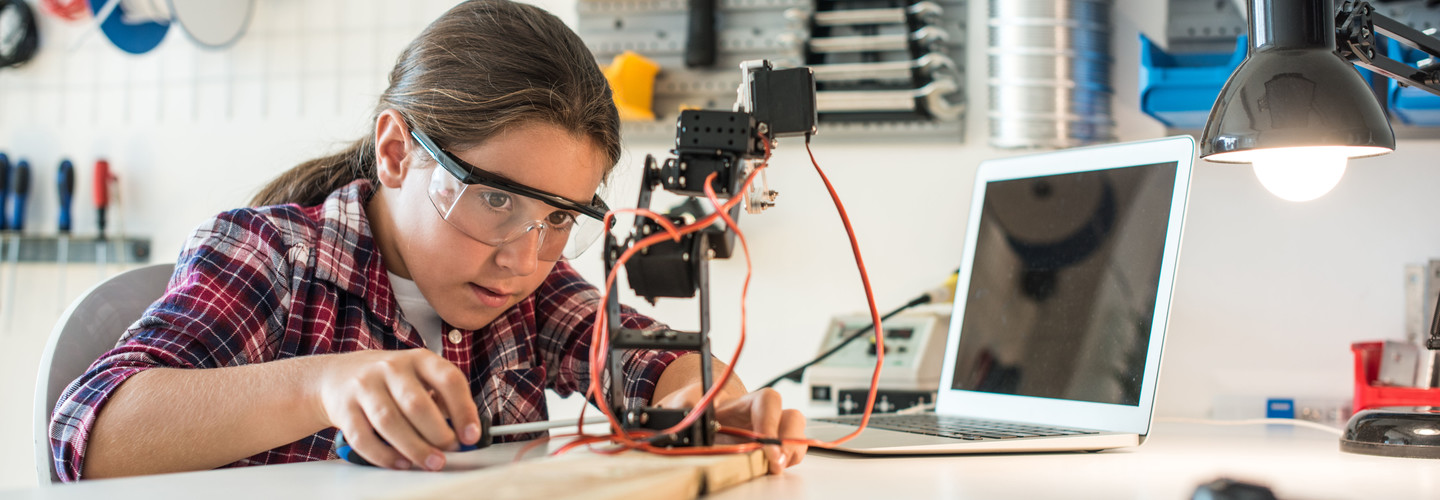 Girl works on engineering project.