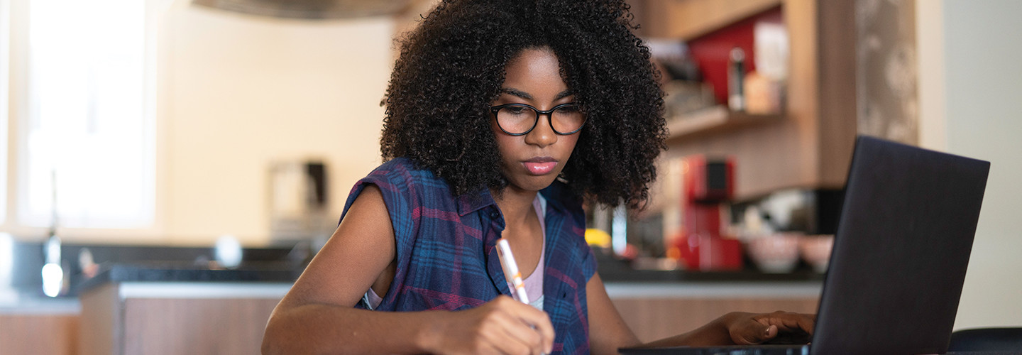 teenager girl studying in the kitchen