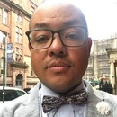 Headshot of Dave Robles wearing glasses and bowtie