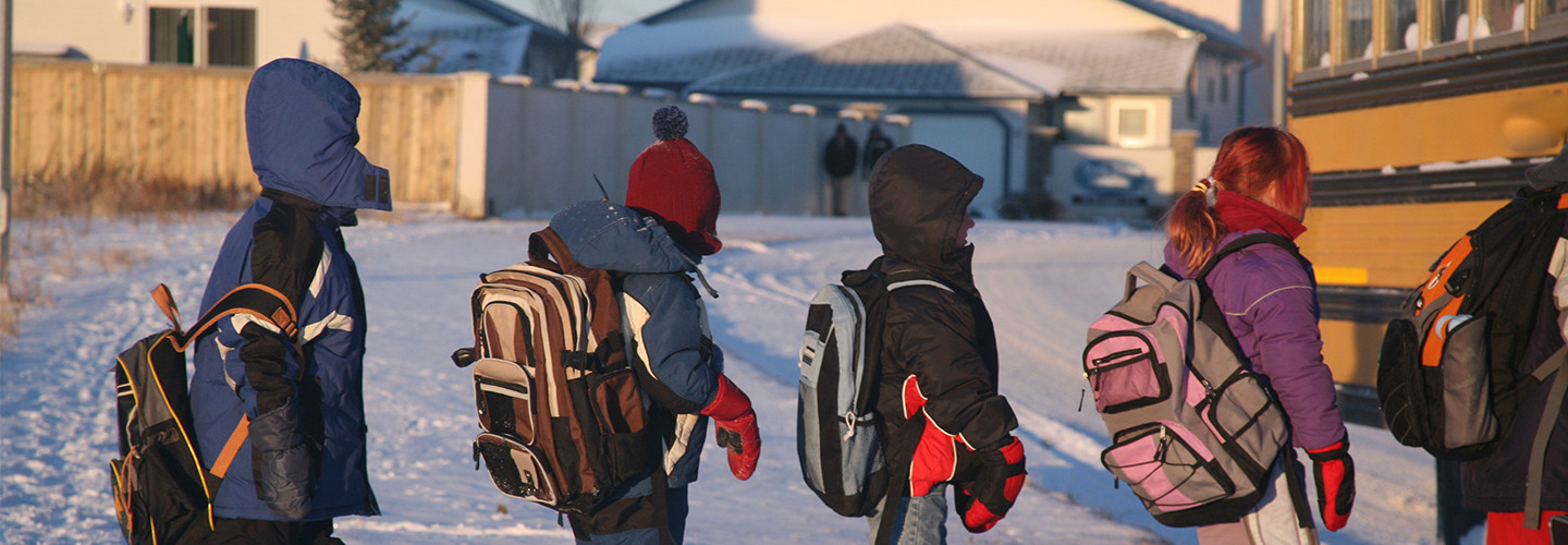 kids in line during a snow day to get on the bus