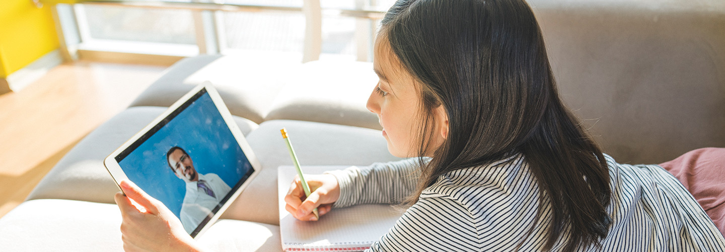 Girl remote learning on tablet