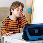Boy using tablet at home