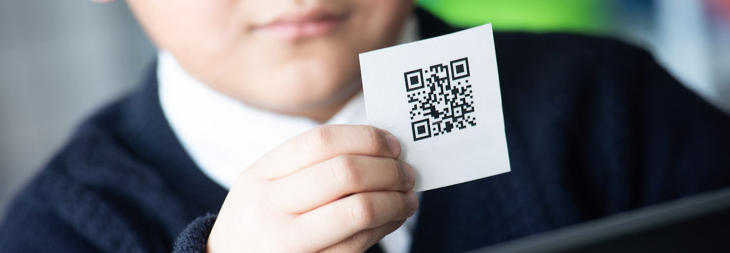 Kid with QR code card