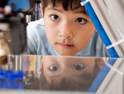 Boy watches 3d printer