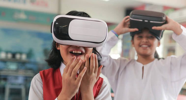 two kids using a vr headset