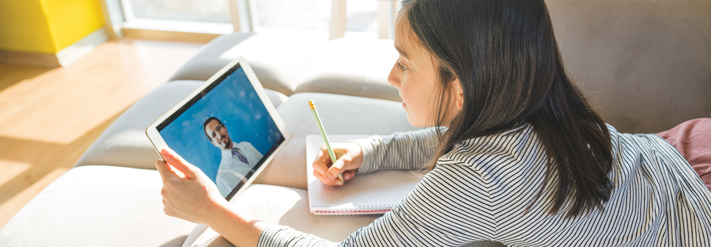 girl studying online from tablet