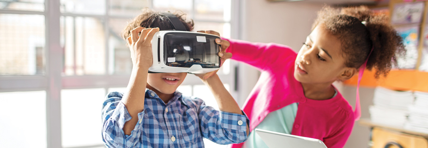 Kids use AR devices for education