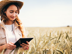 Girl in field with tablet