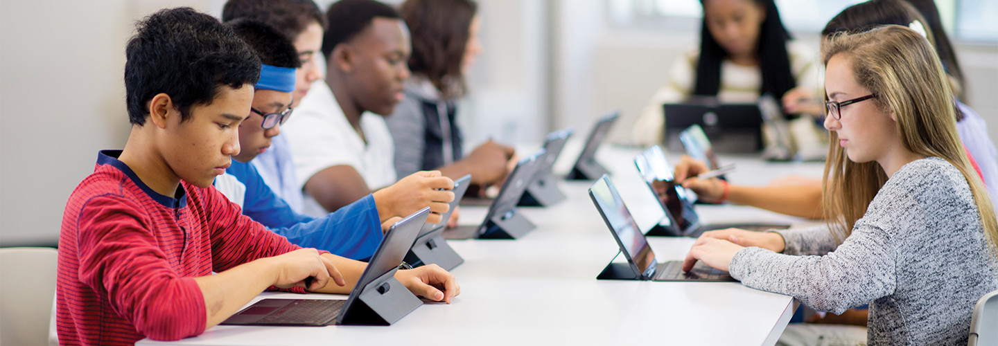 students using tablets in a classroom