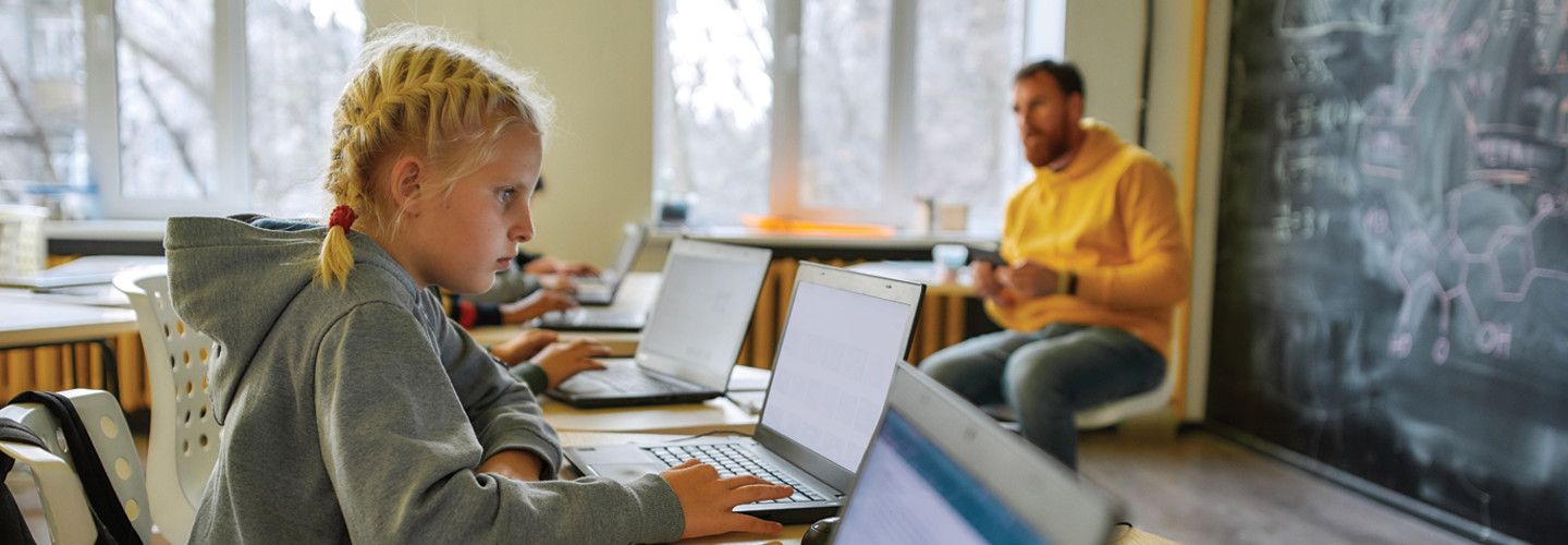 Students on laptops in classroom