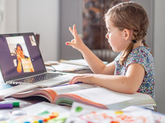 little girl learns from home while teacher teaches remotely
