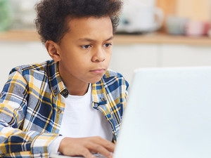 boy doing remote learning