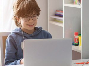 boy using laptop at home