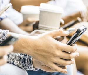 Hands using phones