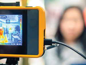 people waiting for temperature scan