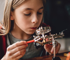 girl tinkering with robot