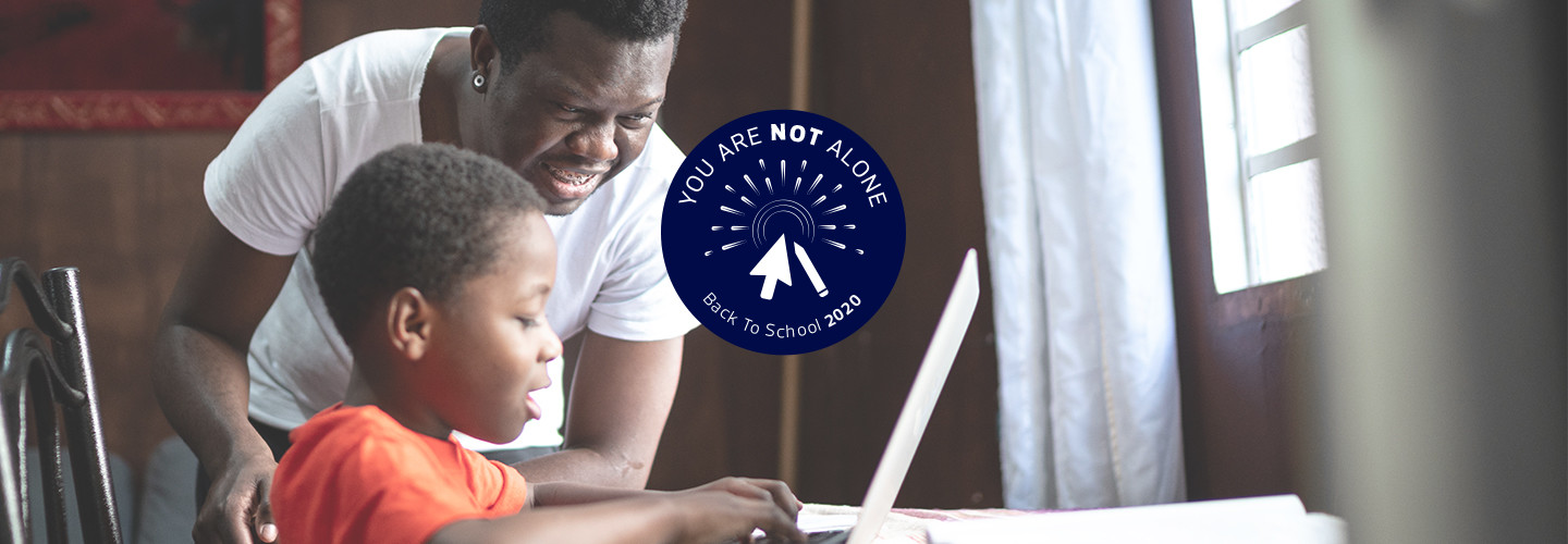 father helping son with online homework