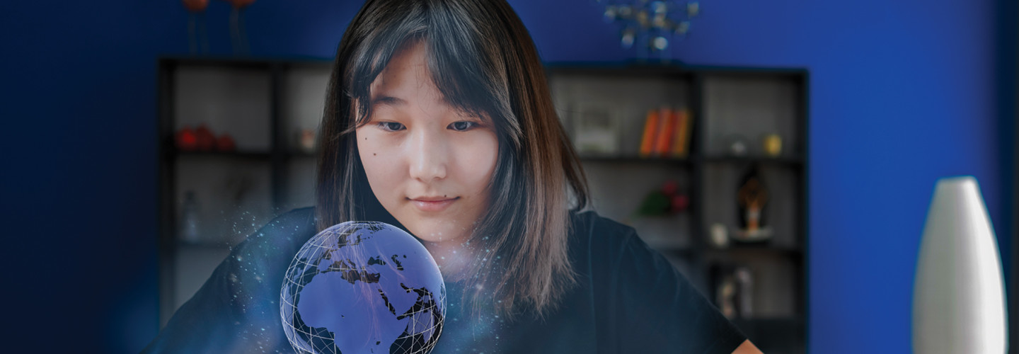 World language student uses technology to view a holographic projection of globe