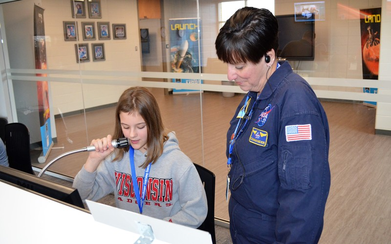 Teacher with student at the Challenger Learning Center