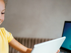 Girl on tablet and computer for e-learning