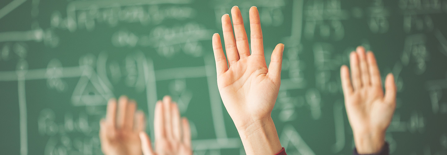 Hands in a classroom