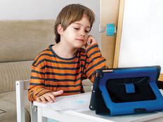 Boy using tablet for remote learning