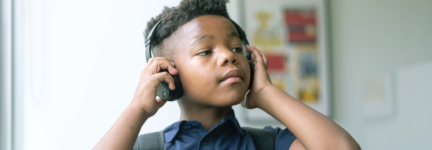 K–12 student with headphones EdTech Essentials