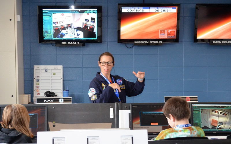 Teacher leading class at Challenger Learning Center
