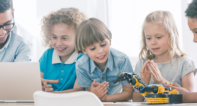 Kids with robot and laptop