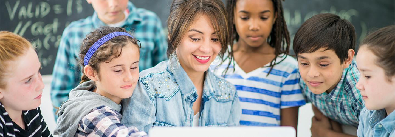Kids and teacher using internet