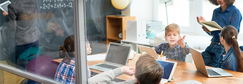 kids in school on tablets