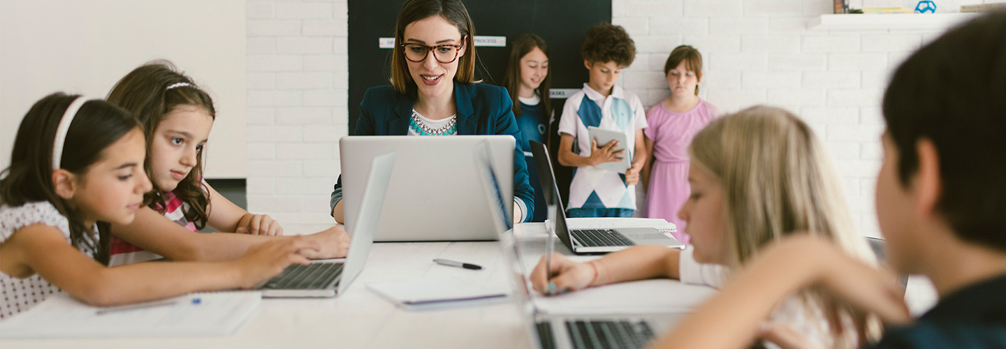 Students and teacher on computers