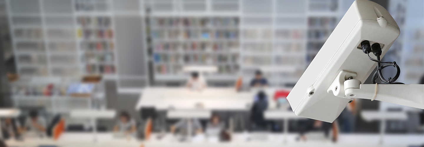 Camera overlooking students in the library