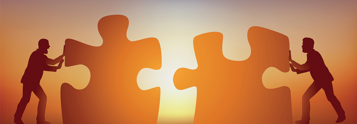 two men putting a puzzle together concept photo of partnership