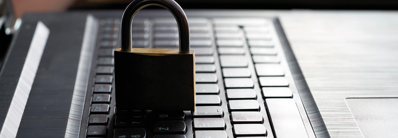 padlock on laptop keyboard