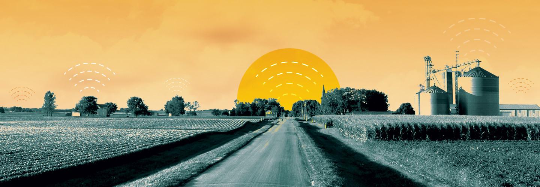 rural farm with sun setting
